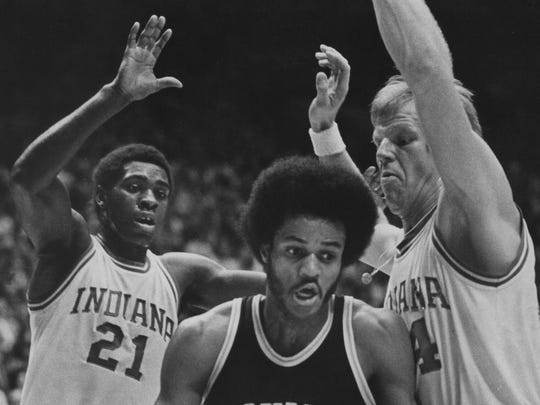 Indiana guard Quinn Buckner (left) and teammate Kent Benson (right) combine to stop a baseline drive offered by Michigan's Rickey Green during during overtime Feb. 8, 1976 at Assembly Hall.