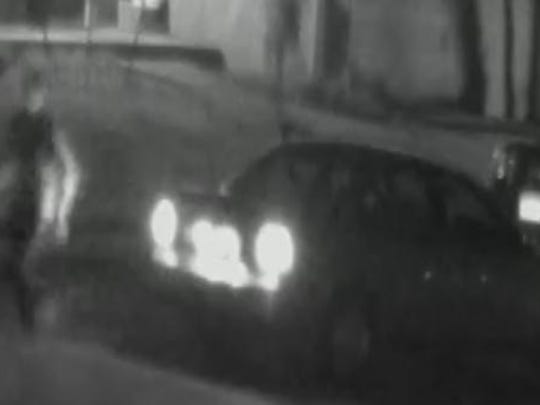 This image taken from surveillance video shows a possible