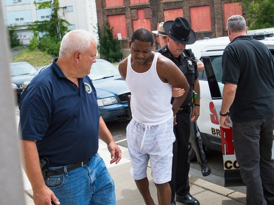 "Terence ""Money"" Wise is led into Johnson City Village Court after police executed an early-morning drug raid July 28 in Endwell."