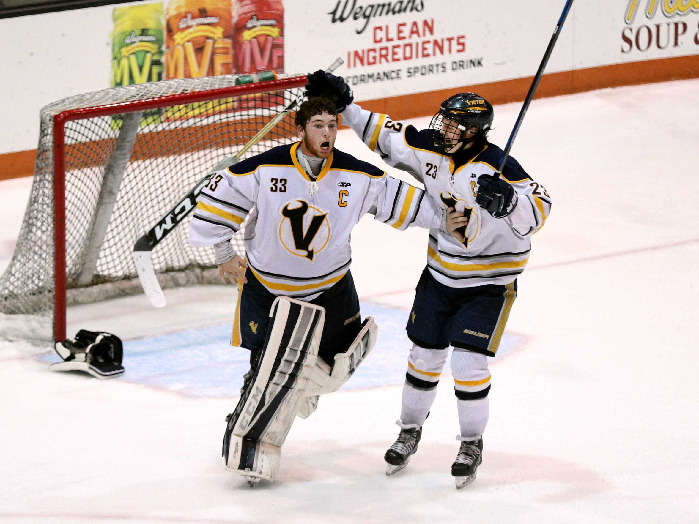 Victor goals Chayse Ierlan celebrates with teammate Andrew Crean (23) after beating Penfield 1-0 to win the Class A championship.  Ierlan made 39 saves and was named MVP.