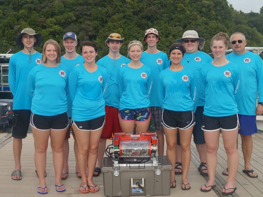The Stockbridge High School underwater robotics team in Palau. Front row: Maddy Armstrong (from left), Jamie Krusinski, Chloe Hypes, Jamie Cool and Becca Ensign. Back Row: Brandon Ostrander (from left), Jeremy Spink, Tyler Heeney, Mitchell Lilley, Philip McCleer and teacher. Robert Richards.