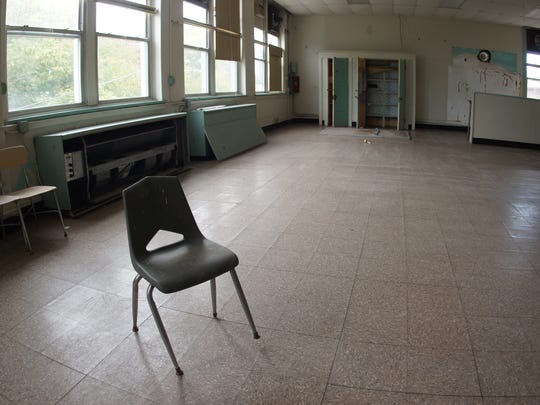 Barnegat, NJ. Tuesday 9/30/14. A lone chair sits in the cafeteteria of the abandoned Elizabeth V. Edwards school.  Urban legend claims the building is haunted. Staff photo by: Brian Johnston Asbury Park Press, Video available.
