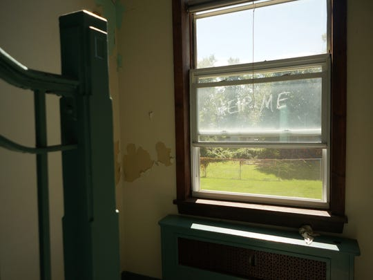 "Barnegat, NJ. Tuesday 9/30/14. ""Help Me"" written on the window in the abandoned Elizabeth V. Edwards school.  Urban legend claims the building is haunted. Staff photo by: Brian Johnston Asbury Park Press, Video available."
