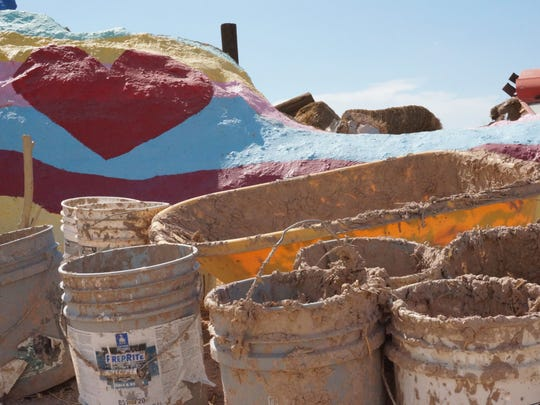 Buckets pictured here were filled with mud and straw to create adobe for patching parts of Salvation Mountain. (August 2014)