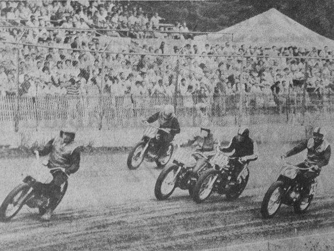 Motorcycles race on Marathon Park's track during Fourth of July festivities in 1965.