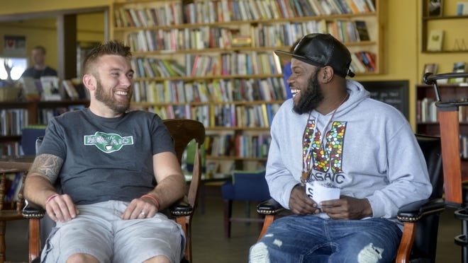 """Drew Collins, left, and Zookie McGee joke at Cafe Mosaic in Benton Harbor. """"You couldn't make up a story like this,"""" McGee said. """"It's too unreal."""""""