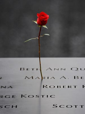 A rose is placed on an inscribed name along the North Pool of the 9/11 Memorial during the 10th anniversary ceremonies of the Sept. 11, 2001 terrorist attacks at the World Trade Center site in New York City.