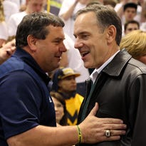 Feb. 12, 2013; East Lansing, MI, USA; Michigan Wolverines football head coach Brady Hoke and Michigan State Spartans football head coach Mark Dantonio greet each other before a basketball game at Jack Breslin Students Events Center.     Mandatory Credit: Mike Carter-USA TODAY Sports