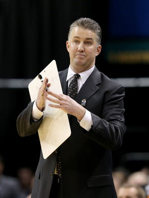 PurdueÕs head coach Matt Painter calls timeout in the second half of game during the Big Ten Men's Basketball Tournament Thursday, March 13, 2014, at Bankers Life Fieldhouse.