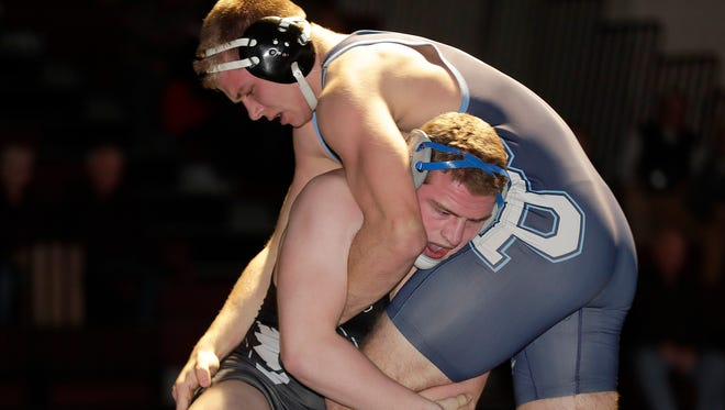 Bay Port's Max Meeuwsen battles against De Pere's Charlie Hooyman during an FRCC wrestling dual meet at De Pere High School Thursday, January 25, 2018 in De Pere, Wis.