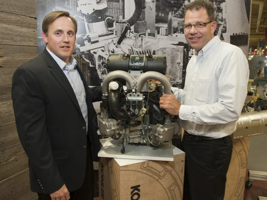 Kohler Engines executives show off a new generator.
