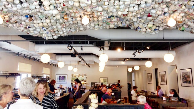 Inside the Cafe at Thistle Farms, with its .china teacup ceiling sculpture