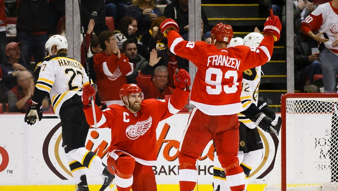 Detroit Red Wings left wing Henrik Zetterberg (40) celebrates with left wing Johan Franzen (93) after scoring a goal against the against the Boston Bruins in the second period at Joe Louis Arena.