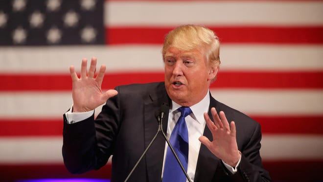 Republican presidential candidate Donald Trump gestures as he speaks to veterans at Drake University on January 28, 2016 in Des Moines, Iowa. Donald Trump held his alternative event to benefit veterans after withdrawing from the televised Fox News/Google GOP debate which airs at the same time.