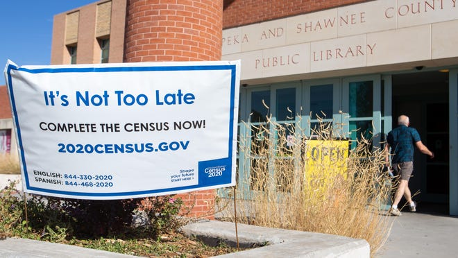 The Topeka and Shawnee County Public Library encourages its patrons to complete the 2020 census with a sign outside the front entrance.