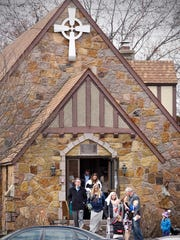 Worshipers leave following mass Sunday at Immaculate Conception Church in St. Cloud.