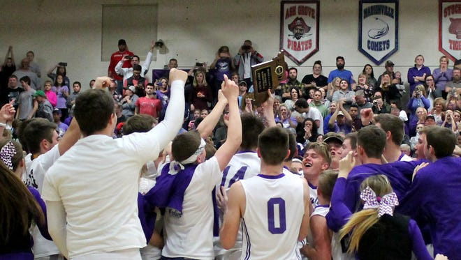 Fair Grove High School basketball players and students celebrate the Eagles winning the Class 3 District 11 boys basketball championship Feb. 25, 2017 at Fair Grove.