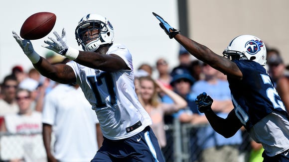 Titans wide receiver Dorial Green-Beckham (17) pulls in a pass over defensive back Marqueston Huff (28) during practice at St. Thomas Sports Park Saturday Aug. 1, 2015, in Nashville, Tenn.