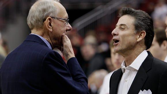 Louisville coach Rick Pitino, right, and Syracuse coach Jim Boeheim talk before their 2011 game at the KFC Yum! Center.