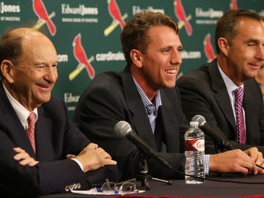 From left, St. Louis Cardinals Chairman Bill DeWitt,  Stephen Piscotty, center, and team general manager John Mozeliak smile during a press conference after signing Piscotty to a long term contract, during a press conference Monday, April 3, 2017, in St. Louis.  (J.B. Forbes/St. Louis Post-Dispatch via AP)