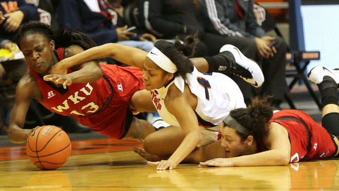 UTEP's Lulu McKinney, center, scrambled for the loose basketball against Western Kentucky's Malaka Frank, left, and Kendall Noble during the second quarter Thursday.