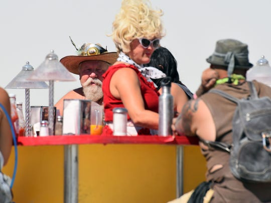 Volunteers at the Dust City Diner serve coffee and pancakes to anyone who wanders up to the mobile diner in the middle of the desert at Burning Man.
