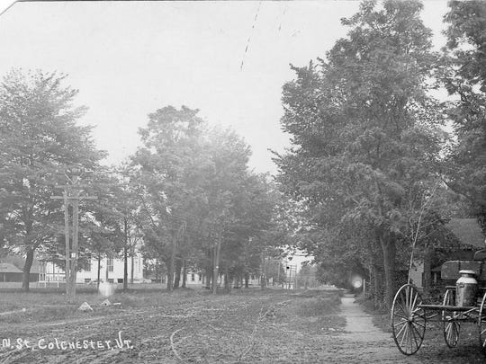 Main Street in Colchester in 1900. The Burnham Memorial Library is located at the site of the gazebo on the left.