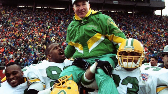 Oregon coach Rich Brooks is carried onto the field after the Ducks won the 1994 game 17-13 in Corvallis to earn their first Rose Bowl berth in 37 years.