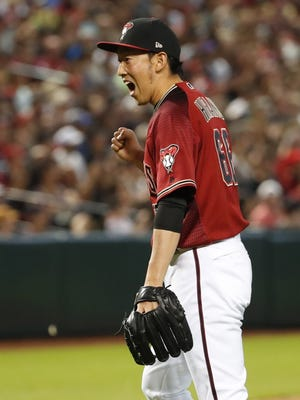 Arizona Diamondbacks relief pitcher Yoshihisa Hirano (66) reacts after getting the third out against the Houston Astros  during the seventh inning at Chase Field in Phoenix, Ariz. May 6, 2018.