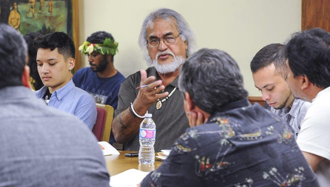 Commission member Joe Garrido addresses Gov. Eddie Calvo with his concern of requesting the expertise of the University of Guam personnel in assisting the Commission on Decolonization during a meeting at Adelup on Wednesday, April 6.