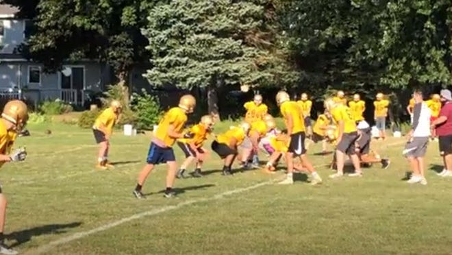 North East's football team lines up for a play last weeK at practice.