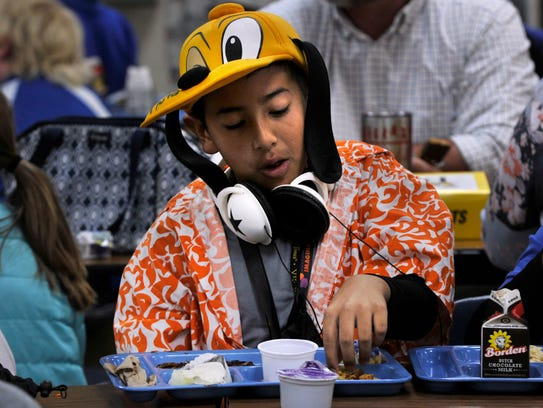 Abilene Christian School fifth-grader Nate Garza eats lunch in the school cafeteria Tuesday. It was Tourist Day at ACS, where students dressed-up as people on vacation in different locales around the world.