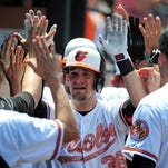 Orioles catcher Caleb Joseph high fives teammates after