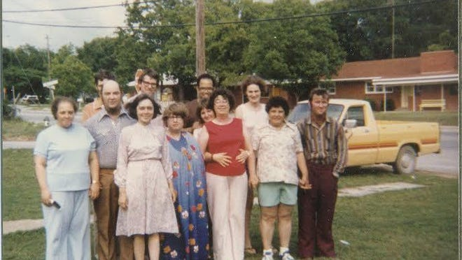 Pictured are the first 13 clients that Rock House had when it was established 40 years ago.