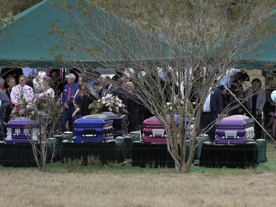 A graveside service is held for members of the Holcombe