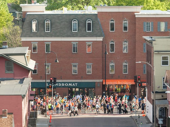 Runners fill Pearl Street just after the start of the
