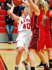 Brandon Valley's Elsie Zajicek looks for some help as she's trapped by two Brookings defenders in the second half of the Lady Lynx's 48-40 win over the Bobcats. The victory improves the Lynx to 5-4 on the season.
