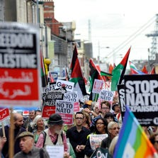 Demonstrators march during a protest attended by about 600 people ahead of the upcoming NATO Summit 2014, in Newport, Wales, Britain, on Aug. 30, 2014.