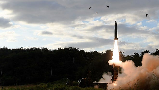 In this handout photo released by the South Korean Defense Ministry, South Korea fires a Hyunmu-2 missile into the East Sea during a drill aimed to counter North Korea's missile.