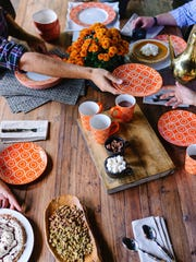 Designer Brian Patrick Flynn  likes to keep things casual by dining outdoors not only to look at the beautiful fall foliage, but also to take advantage of the brisk weather.