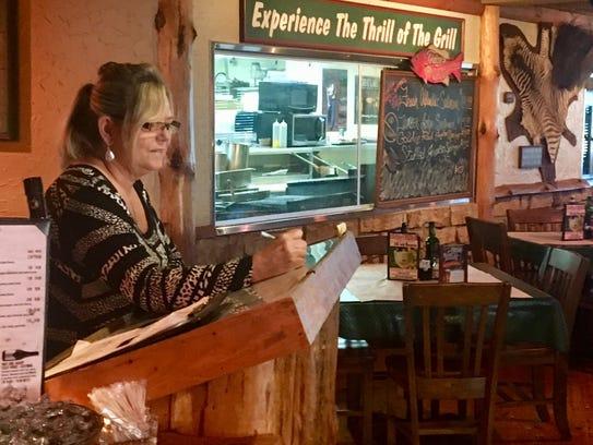 Helen Phelps, a manager at Steve's Dakota Grill, prepares