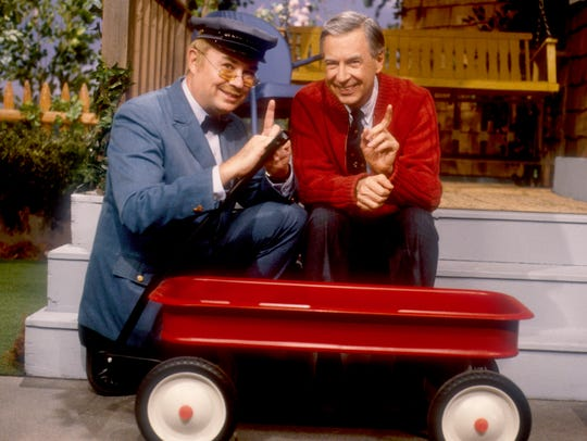 Delivery man Mr. McFeely (David Newell, left) and Mr.