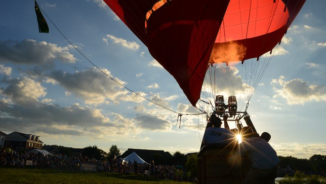 Pilot Logan Bedford of Middle Tennessee Hot Air Adventures sets up his balloon at the second annual Franklin Balloon Festival at Westhaven on Saturday evening. The festival enjoyed a clear day as hundreds of guests relaxed with live music, eclectic food and tasty beverages as balloon pilots prepared for an evening demonstration.