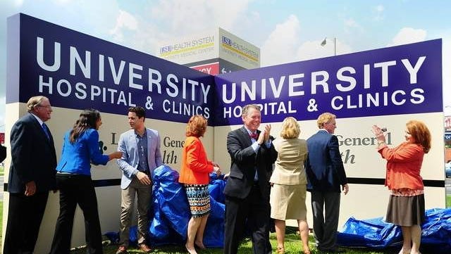 Officials unveil the new sign at University Hospital.