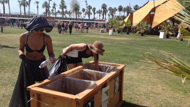Lazzuly Mello (back) and friend Peliala Collins are sorting through collection bins searching for empty bottles at the Coachella Valley Music and Arts Festival on Sunday.