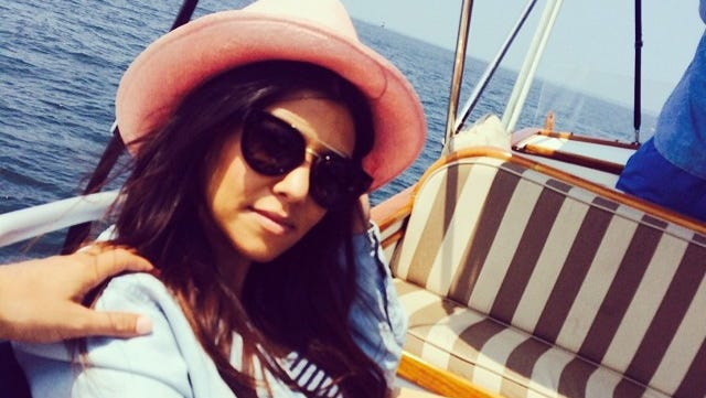 Kourtney Kardashian enjoys the summer sun in the Hamptons while on a boat.