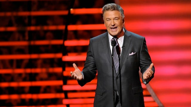 Actor Alec Baldwin hosts the third annual NFL Honors at Radio City Music Hall on Saturday, Feb. 1, 2014, in New York. He says he 'can't live in New York anymore' and blasts the paparazzi in an online article.