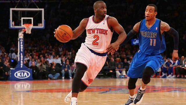 New York Knicks point guard Raymond Felton (2) dribbles the ball in front of Dallas Mavericks shooting guard Monta Ellis (11) during the third quarter at Madison Square Garden Monday, Feb. 24, 2014.. Dallas Mavericks won 110-108. Felton was arrested hours after the game on weapons charges.