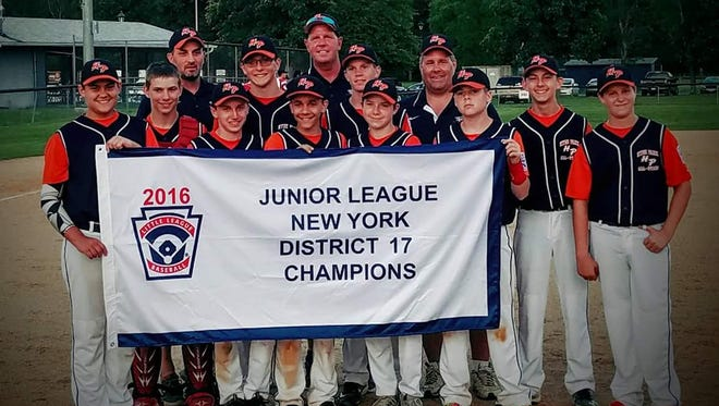 The Hyde Park juniors 13-14-year-old baseball team poses after winning the District 17 championship on Tuesday.