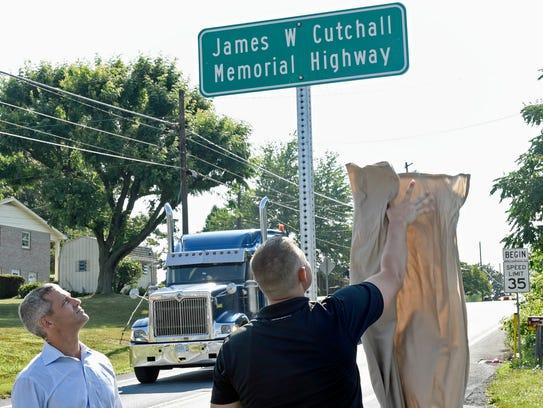 Rep. Robb Kauffman, left, watches as Jacob Cutchall